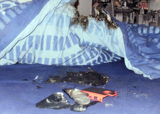 COVENTRY, UNITED KINGDOM - 4 DECEMBER, 2012: Kian's bed just after the phone had exploded.  See NTI story NTIBB. An 11-year-old boy suffered burns to his legs from a mobile phone that exploded and set fire to his bed. Kian McCreath from Coventry, woke up screaming when his brother's Blackberry erupted into flames setting his duvet and mattress alight in the bedroom they share. The schoolboy had melted plastic stuck to his legs and was taken to hospital.     (Photo by Newsteam)