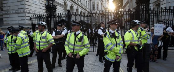 Police stand guard outside Downing Street during an event organised by Stop the War Coalition to protest against potential UK involvement in the Syrian conflict in London.